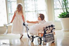 What a perfect way to involve even the littlest of guests in your ceremony! And we love the customized wagon! #Disney #wedding #flowergirl