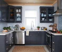 Shaker Style Kitchen Cabinet Painted In Benjamin Moore 1475 Graystone The Walls Are Benjamin Moore Dove Wing The Tile On The Backsplash Is From