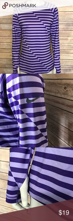 {nike} purple striped long sleeve top Nike Pro fitted Dri-Fit top. Light and dark purple horizontal stripes with diagonal details. Nike logo on the arm. Holes for your thumbs. The lining is so, so soft! This would be a warm top for cool weather workouts. Nice athletic shirt. Nike Tops Tees - Long Sleeve