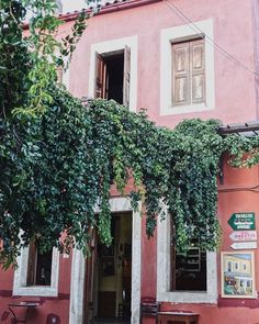Pink facade and #plant_problem in Archanes.