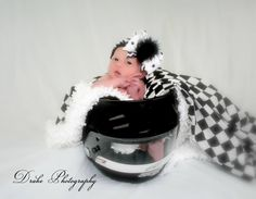 Race theme newborn photography.