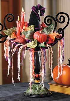 Practice decorative magic by casting a spell over visitors with the colorful mix of autumnal elements in our stunning Witchcraft Display.