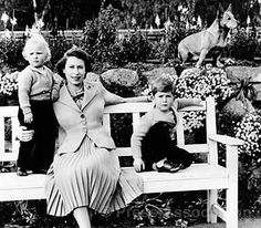 Princess Anne, Queen Elizabeth II & Prince Charles and one of their Corgis