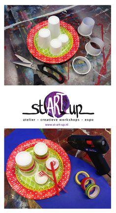 Make your own little drumset! / Maak je eigen drumsetje.  Nodig: Kartonnen bordje, plastic bekertjes, ijsstokjes en kraaltjes.