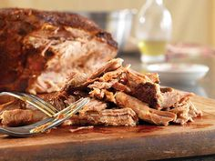 Chili Rub Slow Cooker Pulled Pork Recipe... Great for tailgating or a delicious meal at home.