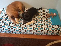 DIY dog bed made with a baby crib mattress and fabric cover.