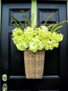 I like this idea... Hang a basket from your front door and just change the flowers depending on what season it is :) Except I kill all flowers.