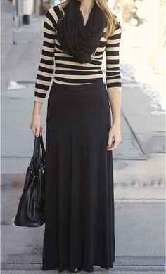 A plain black maxi skirt pairs well with a striped top.  If it's chilly pair it with a matching infinity scarf to complete the look.  Create this same look and order a black MHOC maxi skirt for only $14.99 on Amazon.