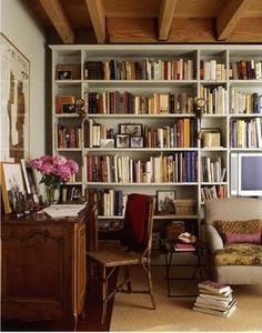 Wish: wall to wall bookshelves, wood ceiling, comfy couch, lots of books...
