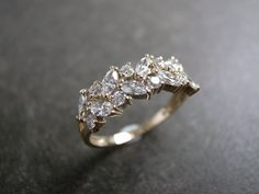 The only gold engagement ring I would ever want. Beautiful & so unique!   Marquise Diamond Wedding Ring in 14K Yellow Gold by honngaijewelry