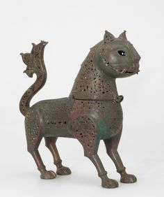 The Arts of Islam. Masterpieces from the Khalili Collection,Incense Burner or Pomander in the Form of a Lynx  Iran  late 12th or early 13th century AD