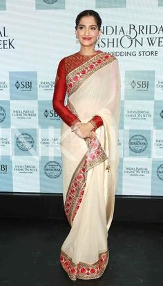 Sonam Kapoor goes traditional in a red and white saree, looks like a million bucks!