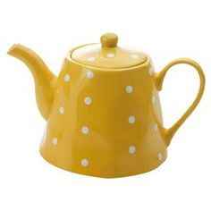 Stoneware teapot in yellow with white polka dots.  Product: TeapotConstruction Material: StonewareColor: YellowFeatures: 40.5 Ounce capacityDimensions: 6.5 H x 9.2 W x 6.1 D