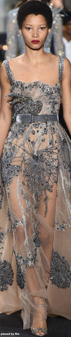 Grey velvet under dress same velvet as belt. Nix belt\define waist. Nix heart piece. Stop dress at below-calf.