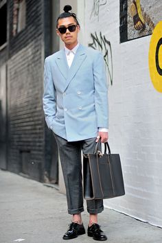 Damien (30 - Student) Suit by Balenciaga, Shirt by Dior, Shoes by APC, Sunglasses by Tom Ford, Bag by Comme des garçons and a ring by Chrome Hearts