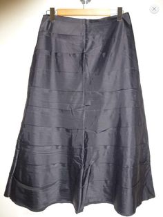 Beautiful long and stylish formal skirt from SCARLETT (NZ). Sz10  Has stretch to the material. There is an invisible zip on the right. The skirt has a number of panels and has an A-line shape.  Measurements taken flat are as follows: Waist:   39cm Hips:   52cm Length:   90cm