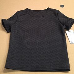 Black short sleeve top new with tag Black Cheryl creations New York size small top. Adorable with jeans or can be dressy and worn with a skirt. Round neck with diamond quilted pattern and fitted body Cheryl creations Tops