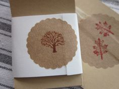 Hand stamped Kraft paper seal with a family tree and oak leaves