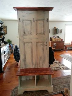 Door hall tree made from an antique door and a custom bench and shelf to fit.  The finish is an old worn look - a bit rustic for me.  I like the functionality - might add a few more hooks and cubby shelf up top.