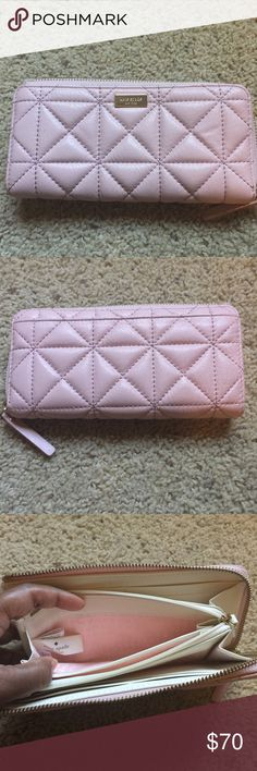Kate Spade Whitaker place wallet These pretty color is Cipria (Pale Pink with a slight shimmer) Quilted pebbled leather with a shimmer finish  and pebbled leather trim capital kate jacquard lining  zip around continental wallet  8 credit card slots;  3 billfolds;  interior zip pocket;  exterior slide pocket  gold staple kate spade new york signature it's in fair condition has a mark in last picture. Other than that needs a new home. Price is firm and fair. kate spade Bags Wallets