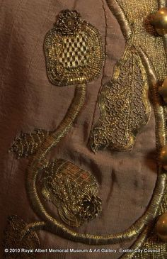 Detail of metal gilt thread embroidery to front of child's waistcoat, 1727-1760, England, silk (corded), Metal gilt (threads and spangles). Royal Albert Memorial Museum & Art Gallery