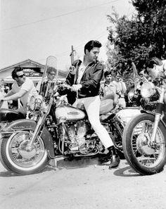 Elvis riding on his Harley Davidson 1954