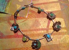 Dorothy Ganek: Fabricated Sterling Silver necklace with semi precious stones