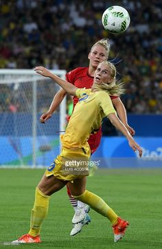 Germany's defender Leonie Maier (back) and Sweden's striker Sofia Jakobsson vie…