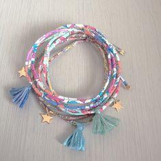 Bracelet Liberty cousu fin, étoile en plaqué or et pompon en fil de coton. Création ticha. Handmade in France. www.ticha.bigcartel.com