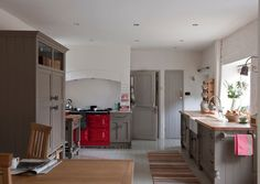 Farmhouse Kitchen by absolute abode design not sure i love the red aga with the cabinet color.  pop of color, yes.  with these cabinets, not so sure.  but do love the boldness.