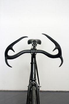 worclip:Moniker Cycle Horns (2012) by Taylor SimpsonArtist on Tumblr: via funeralhomeA bicycle handlebar that is made of genuine deer antler...