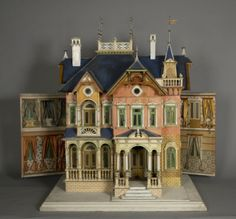 Blue Roof Victorian Dollhouse, circa 1890, manufactured by Morris Gottschalk Company of Marienburg, Germany.