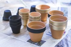 Party decor ideas! Spray paint terra cotta pots for quick and easy table decor - The Revelry Co.
