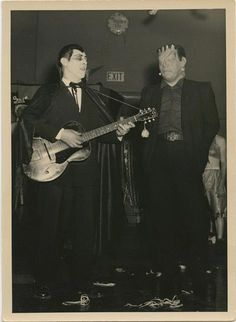 Dracula serenades Frankenstein on the guitar