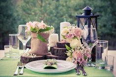 Wedding table setting in rustic style. Forest on background.