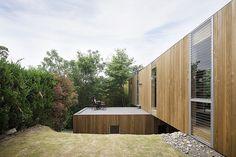 Full-height window with soffit behind new residence, fukuyama/UID Architects via: maeda