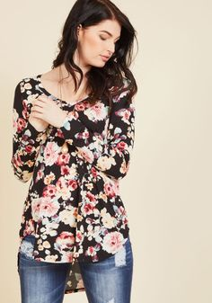 Embracing Basic Long Sleeve Top in Watercolor Blooms | Mod Retro Vintage Short Sleeve Shirts | ModCloth.com  Layer it on or let it stand alone as the star of your outfit - however you style this black floral tunic, you're bound to look adorable! With a V-neck, a soft jersey knit, and a curved high-low hemline, this long-sleeved top - a ModCloth exclusive! - takes the cake as coolest staple we've ever seen.