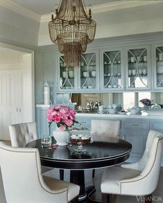 Designer Michelle Workman uses pale-blue cabinets to enhance this already glamorous kitchen.