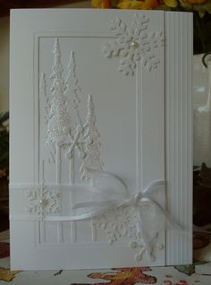 white on white card . start with embossing folder trees . add glitter pears and organza ribbon . create a die cut frame . decorate it with some scoring and a snowflake . end up with a gorgeous winter card . Christmas Tree Cards, Noel Christmas, Xmas Cards, Handmade Christmas, Holiday Cards, Christmas Crafts, White Christmas, 2 Kind, Snowflake Cards