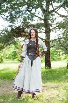 Shieldmaiden with leather corset, and hair I hope is fake because of the feeling of inadequacy it gives me.