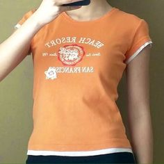 Orange graphic t-shirt Cute orange graphic t-shirt to add a pop of color in your closet! ESPRIT Tops Tees - Short Sleeve