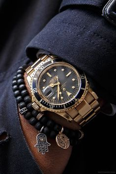 Men daring enough to wear prayer beads, a hamsa with a vintage rolex and suit! 1977 Rolex Submariner (version: - the first gold version Timex Watches, Rolex Watches For Men, Luxury Watches, Cool Watches, Michael Watches, Stylish Watches, Vintage Rolex, Vintage Watches, Gold Rolex