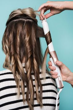 The Secret Behind An L.A. Salon's Signature Waves #refinery29 http://www.refinery29.com/2016/03/105014/riawna-capri-waves-hairstyle-pictures#slide-5 There's a trick to the next section, and while it may seem a bit, er, precise, hear us out. To get the varied texture you see here, simply swap in a slightly smaller iron for the middle section or sections (if you have thicker hair). Capri is using the 1-inch attachment to...