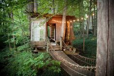 Buckhead Treehouse |  Secluded intown treehouse is made up of three separate areas connected by rope bridges: a living room a deck with a hammock and dart board and a bedroom ...  The post Buckhead Treehouse appeared first on Woodz.  #wood http://www.woodz.co/buckhead-treehouse/