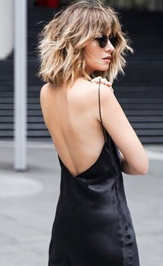 Silks. It's hard to beat a simple slip. Black, backless, spaghetti straps, chic. See more of what we love at https://www.pinterest.com/stolenfrmmysis #silk #dress #black