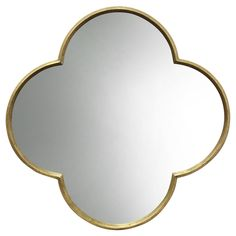 Threshold's Quatrefoil Mirror offers a unique accent piece for any wall in need of added depth and dimension. It takes the shape of the trendy gothic cloverleaf made modern with a metallic gold finish. Hang it over a console in the entryway or dining room to add shine and style.