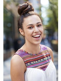 Oversleep? Hide the evidence in a glam top knot. Gather your hair into a high ponytrail and twist into a bun. Then apply a shine serum to smooth out the top.   - Seventeen.com