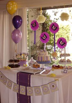 Purple butterflies girl birthday party dessert table! See more party planning ideas at CatchMyParty.com!