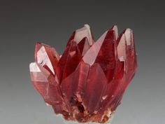 A beautiful specimen of ideal prismatic gemmy hot pink Rhodochrosite crystals from the well regarded Kalahari Manganese Mines, South Africa....