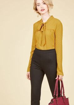 Your social schedule is starting to look pretty full - which means you'll be reaching for this rich yellow top a lot! Featuring a tied neck and a delicate ivory, taupe, and black print, this long-sleeved blouse spiffs you up in an instant for all your stylish engagements.